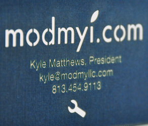 Laser cut business card showing detail of etching and linen texture 